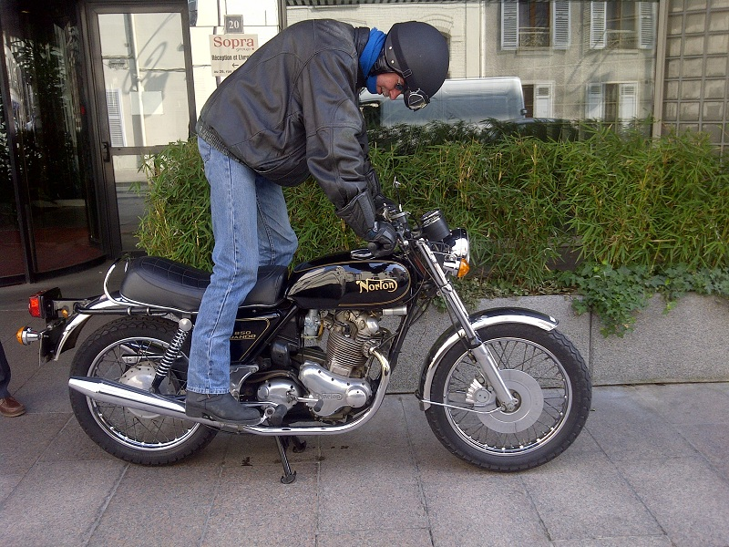 Norton Commando in front of the office